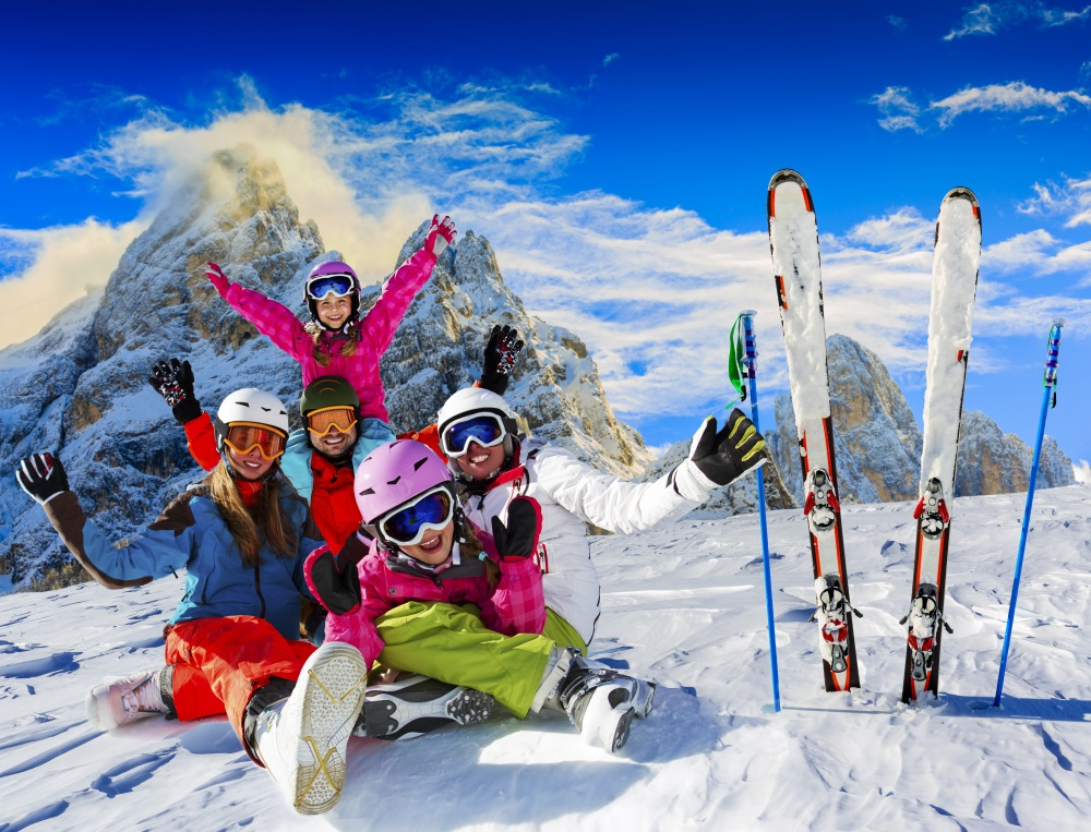 Skiing family enjoying winter vacation on snow in sunny cold day in mountains and fun. San Martino di Castrozza, Italy_662681575.jpg